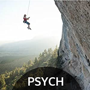 Woman dangles above forest on Trango climbing rope
