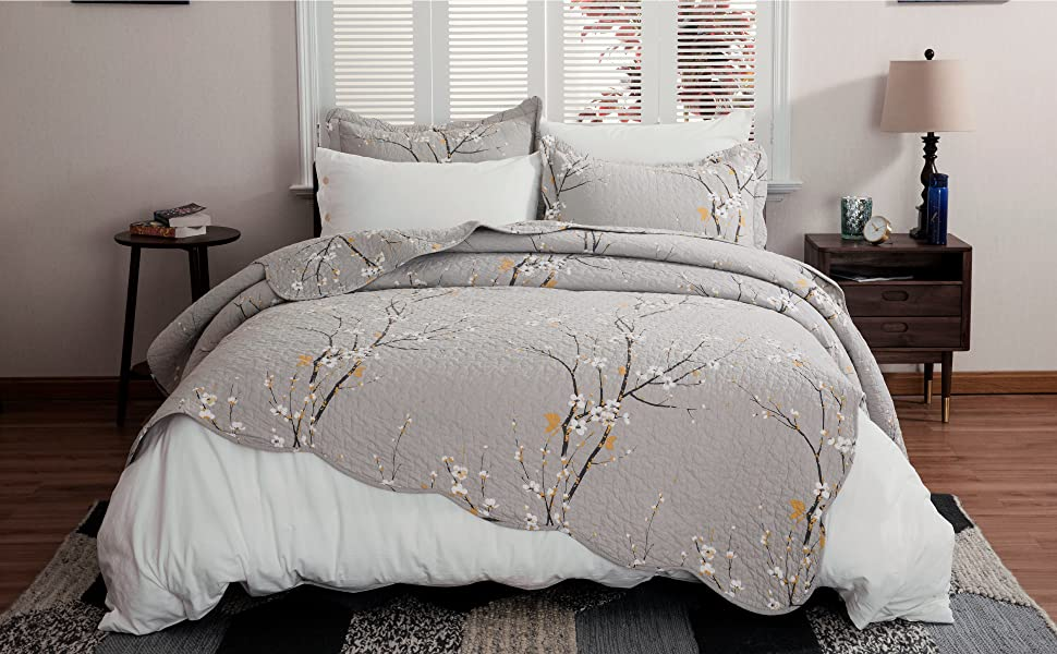 Doze off into a blooming spring oasis with the addition of the Plum Blossom Printed Quilt Set.