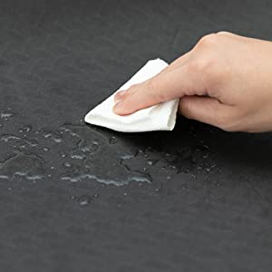 Image of water on mat and wiping it away