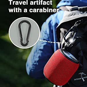 Travel artifact with a carabiner