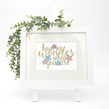 gold how we wonder what you are cake topper with pink and blue stars shown in keepsake frame