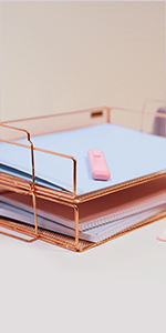 rose gold letter tray placed on an office desk, it can hold papers, letters, folders and notebooks