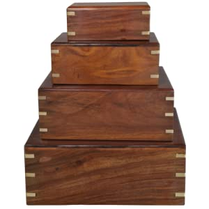 wooden cremation urns in four sizes stacked together