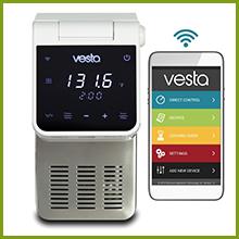 white Imersa Elite precision cooker next to smartphone with Vesta app