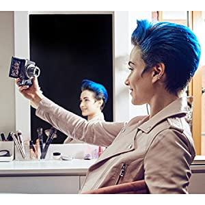 Image of woman with blue hair taking a selfie with a canon powershot g7x mark 3 digital camera