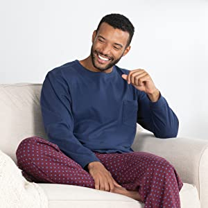 Man in blue and red pajama set on chair