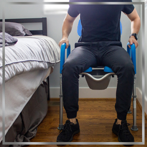 dignity raised toilet seat positioned as bedside commode