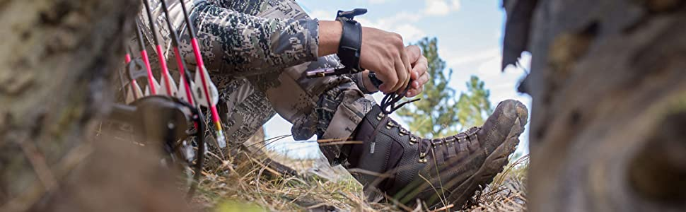 Man lacing his hunting boot