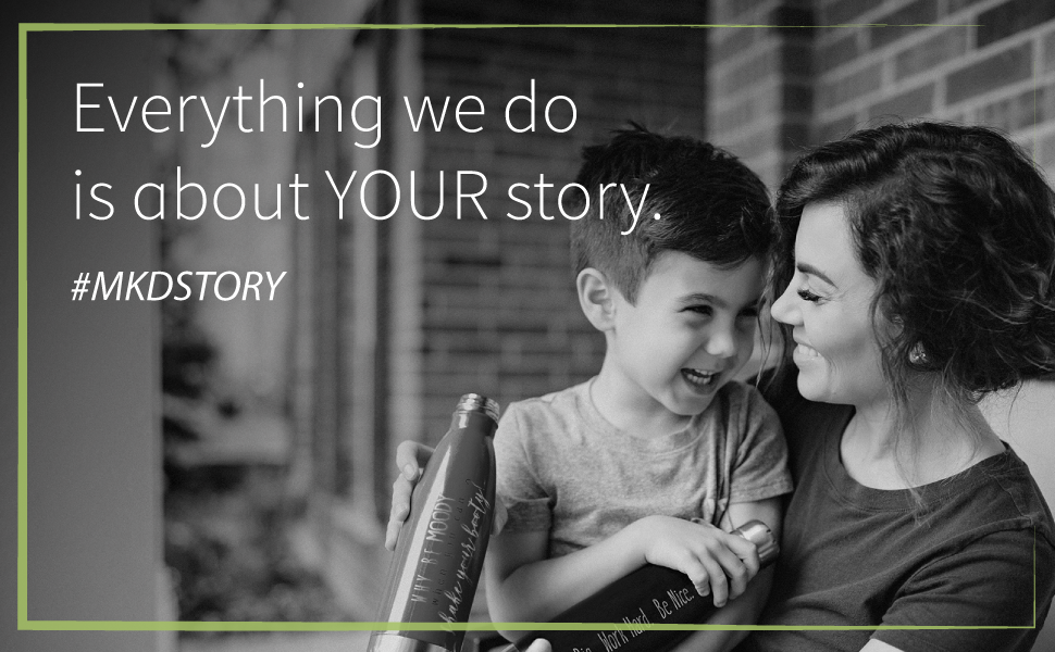 """Mom and son with personalized bottles. Text says, """"Everything we do is about YOUR story. #MKDSTORY."""""""