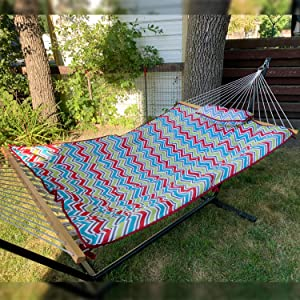 hammock shown on stand with colorful pad