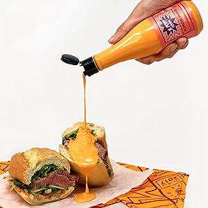kimchi mayo sauce poured on sandwich
