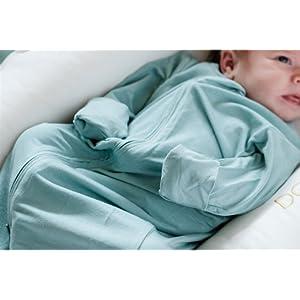 baby boy in sage green gown