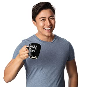 man holding mug