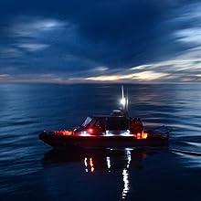Boat navigating on the ocean at sunset/sunrise
