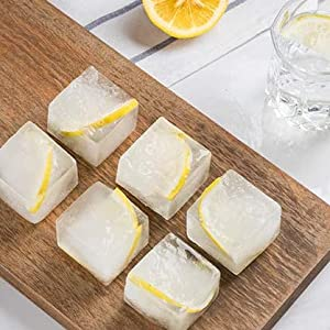 ice cubes with lemons inside for cocktails, cola and so on