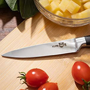 KUMA Paring Knife is a razor sharp utility knife that cuts potatoes, tomatoes and other foods