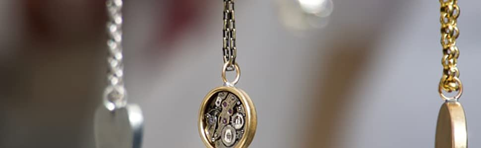 three different color chains with charms on the end