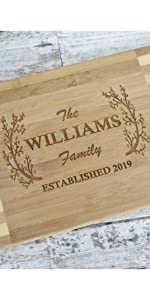 Custom engraved bamboo cutting board with last family name and date for housewarmings or closings