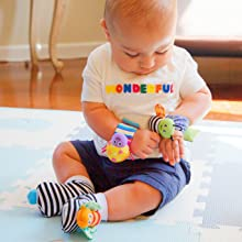 Baby playing with butterfly of Babychino wrist rattle bracelet toy