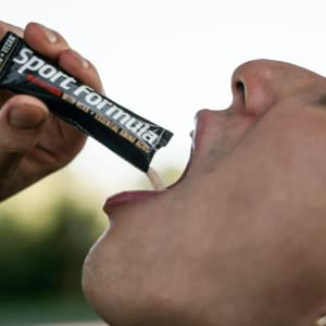 Lifestyle shot pouring great tasting powder into mouth