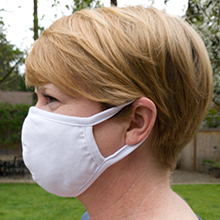 woman wearing cotton face mask with ear loops