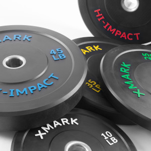 XMark Hi-Impact, dead bounce Olympic bumper weight plates, scattered, with variously colored texts