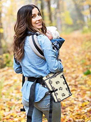 Mom carrying baby diaper change pad