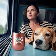 woman in the train traveling with her dog and having a hot coffee in a fancyfams dog mom tumbler