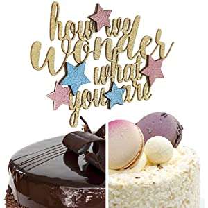 gold how we wonder what you are cake topper with stars shown on two cake styles for comparison