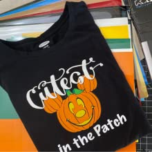 pumkin graphic made with kassa heat transfer vinyl  project on top of htv vinyl sheets
