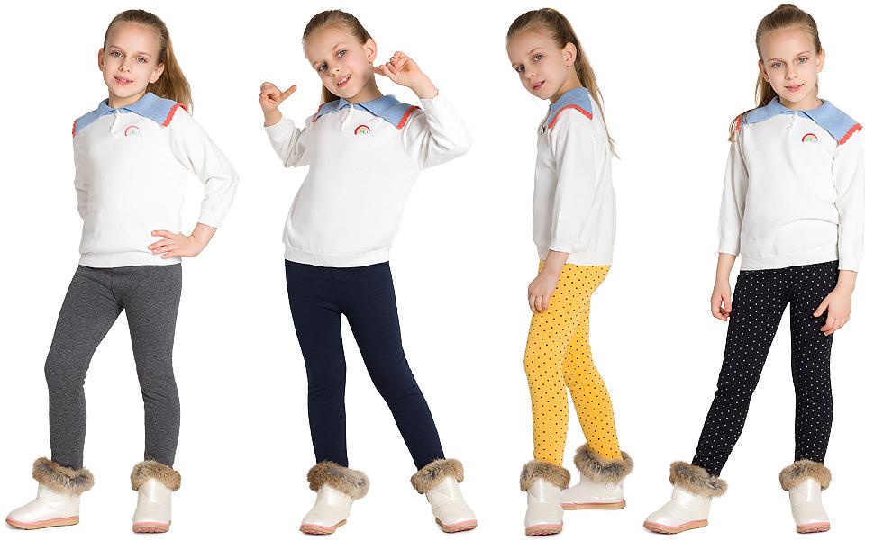 Una niña en pantalones de invierno combinar con jerséis, hacer mover mayor libertad.