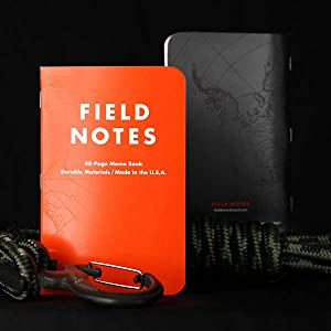 orange and black field notes notebook