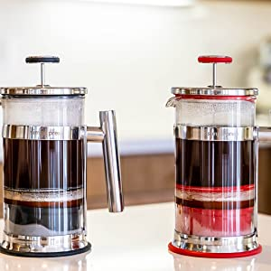 red and black french press coffee