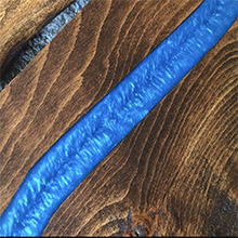 Sample of a wood project with colored casting resin epoxy perfect for dine-in as it is food safe