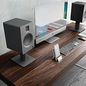 matte black tuk on desktop next to phone