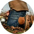 man working and kneeling with a suede outdoor boot
