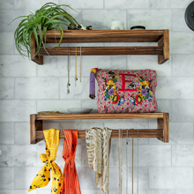 our shelves can be mounted upside down to hang necklaces and trohpies from