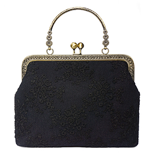 women kiss lock handbag