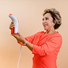 Woman holding a red steam iron