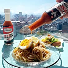 Adoboloco KoloheKid Ghost Pepper and Hawaiian Chili Pepper hot sauce over noodles