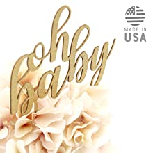 gold oh baby cake topper shown in floral centerpiece arrangement