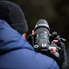 Man taking a photo with gloves on