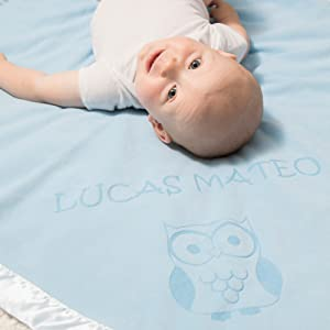Baby on Blue Blanket with Owl Design