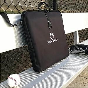 bag of baseball bases on bench