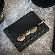 ultra thin black credit card holder zip wallet with coin pocket on the table