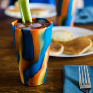 Image shows a bright, colorful Silipint cup in a car cupholder.