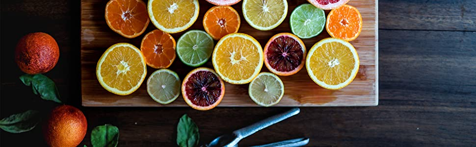 A variety of citrus fruit slices on a cutting board