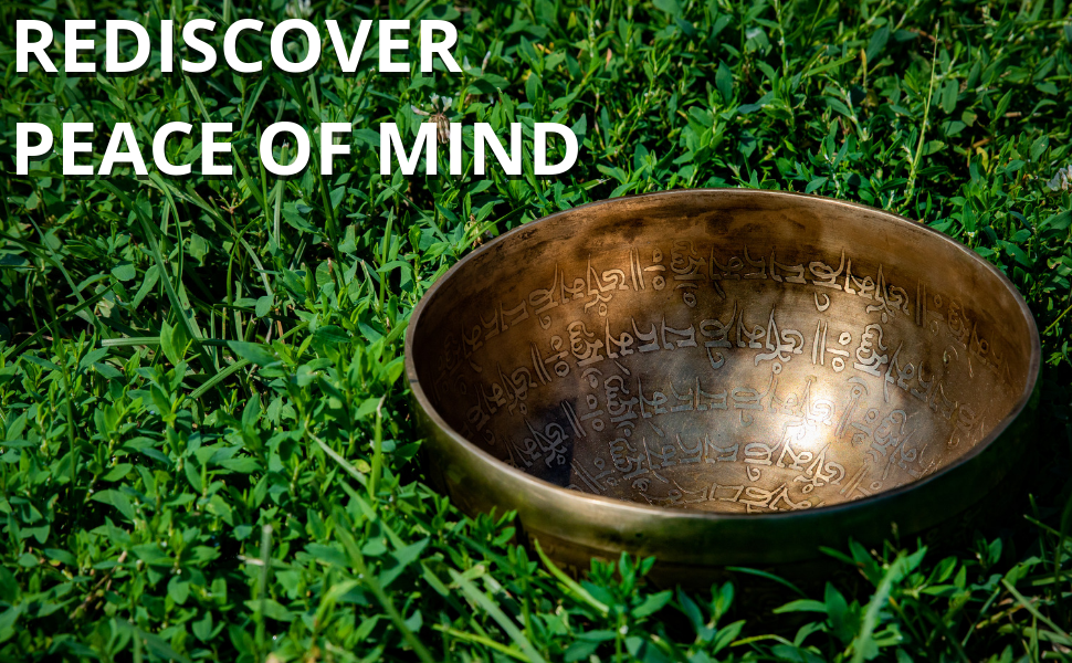 The Ohm Store Tibetan Ancient Singing Bowl laid in grass with the message: Rediscover Peace of mind