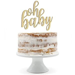 gold oh baby cake topper shown on naked cake