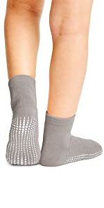 model in low cut blue sport socks with max traction non skid anti slip soles